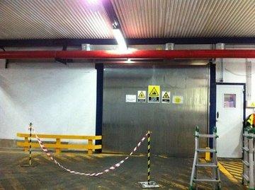 Puertas de Cristal SAP - Puerta industrial  Danone en Salas - Sistemas Automáticos de Paso