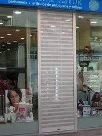 Puertas de Cristal SAP - Persiana. Comercial Astur - Sistemas Automáticos de Paso